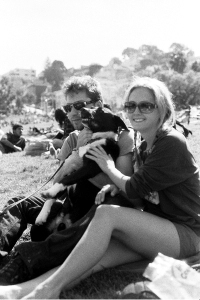 this picture combines 2 things we love: julian and carly enjoy dog in park.